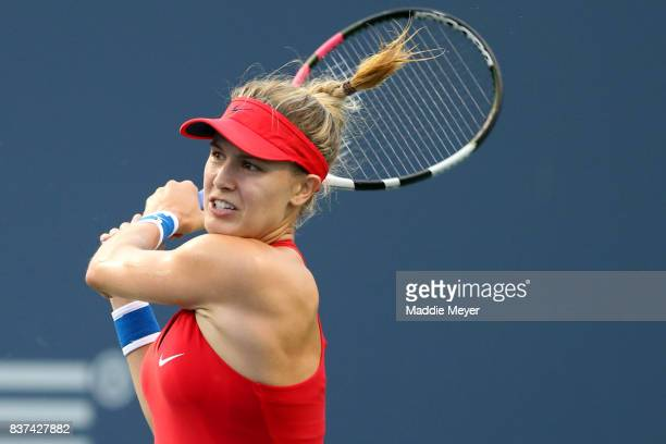 Eugenie Bouchard of Canada returns a shot to Agnieszka Radwanska of Poland during Day 5 of the Connecticut Open at Connecticut Tennis Center at Yale...