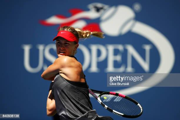 Eugenie Bouchard of Canada returns a shot to Evgeniya Rodina of Russia after their first round Women's Singles match on Day Three of the 2017 US Open...