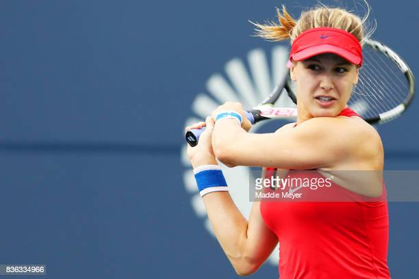 Eugenie Bouchard of Canada returns a shot to Lauren Davis of the United States during Day 4 of the Connecticut Open at Connecticut Tennis Center at...