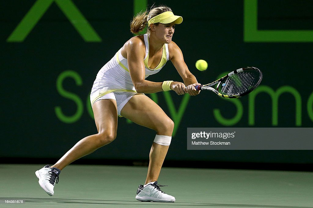 Eugenie Bouchard of Canada returns a shot to Maria Sharapova of Russia during the Sony Open at Crandon Park Tennis Center on March 22, 2013 in Key Biscayne, Florida.