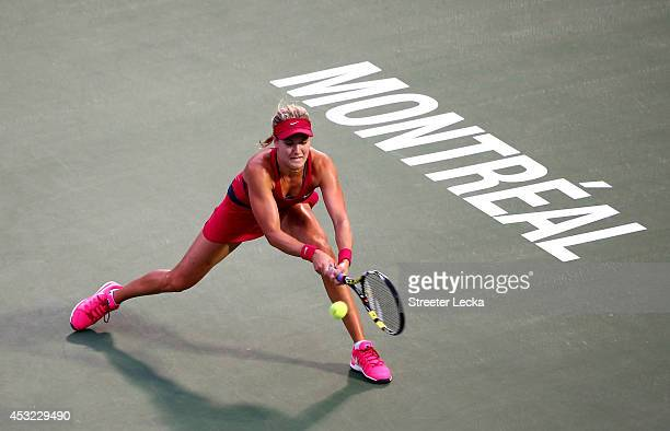 Eugenie Bouchard of Canada returns a shot to Shelby Rogers of the USA during Rogers Cup at Uniprix Stadium on August 5 2014 in Montreal Canada