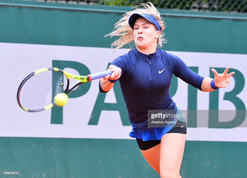 Eugenie Bouchard (C) of Canada returns Laura Siegemund of Germany during their women's single first round match at the French Open tennis tournament at Roland Garros in Paris, France on May 24, 2016.