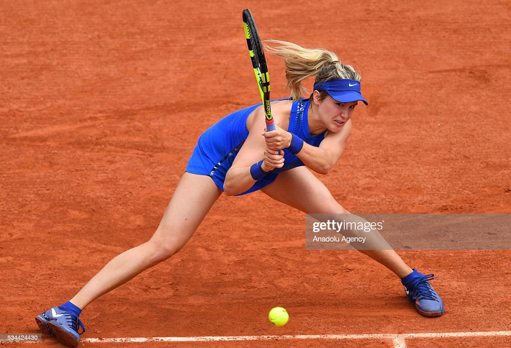 Eugenie Bouchard of Canada returns the ball to Timea Basinszky (not seen) of Switzerland during their women's single second round match at the French Open tennis tournament at Roland Garros in Paris, France on May 26, 2016.