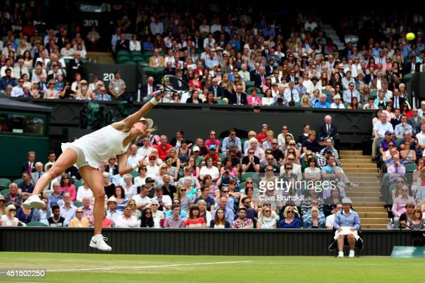 Eugenie Bouchard of Canada serves during her Ladies' Singles fourth round match against Alize Cornet of France on day seven of the Wimbledon Lawn...