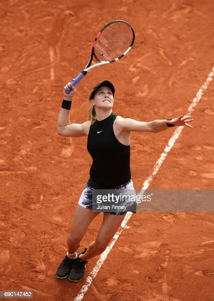 Eugenie Bouchard of Canada serves during the ladies singles first round match against Risa Ozaki of Japan day three of the 2017 French Open at Roland...
