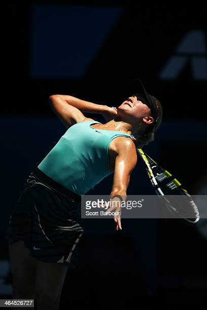 Eugenie Bouchard of Canada serves in her semifinal match against Na Li of China during day 11 of the 2014 Australian Open at Melbourne Park on...