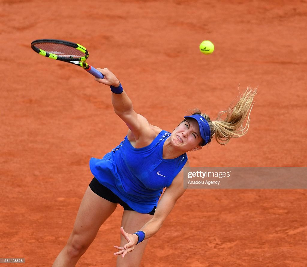 Eugenie Bouchard of Canada serves the ball to Timea Bacsinszky (not seen) of Switzerland during their women's single second round match at the French Open tennis tournament at Roland Garros in Paris, France on May 26, 2016.