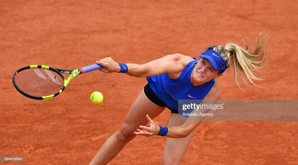 Eugenie Bouchard of Canada serves the ball to Timea Basinszky (not seen) of Switzerland during their women's single second round match at the French Open tennis tournament at Roland Garros in Paris, France on May 26, 2016.