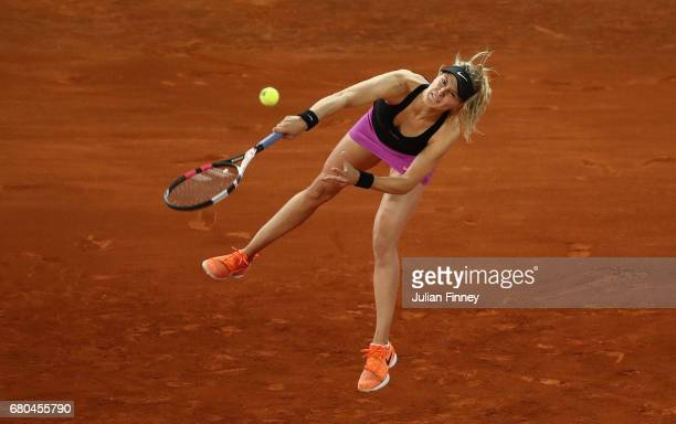 Eugenie Bouchard of Canada serves to Maria Sharapova of Russia during day three of the Mutua Madrid Open tennis at La Caja Magica on May 8 2017 in...