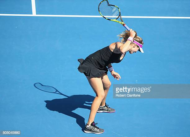 Eugenie Bouchard of Canada smashes her racquet in frustration in her semifinal singles match against Dominika Cibulkova of Slovakia during day six of...