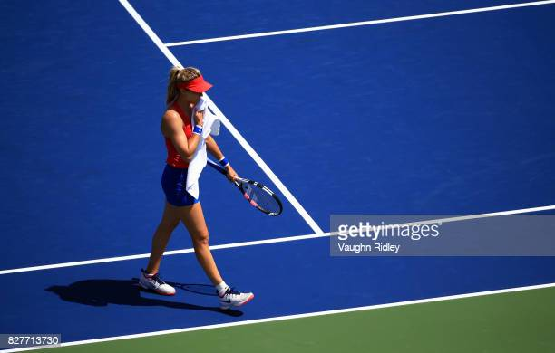 Eugenie Bouchard of Canada walks to her seat during a break in play against Donna Vekic of Croatia during Day 4 of the Rogers Cup at Aviva Centre on...