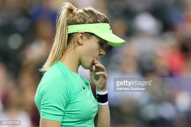 Eugenie Bouchard of Canada wipes her face between points while playing Annika Beck of Germany during the BNP Paribas Open at the Indian Wells Tennis...