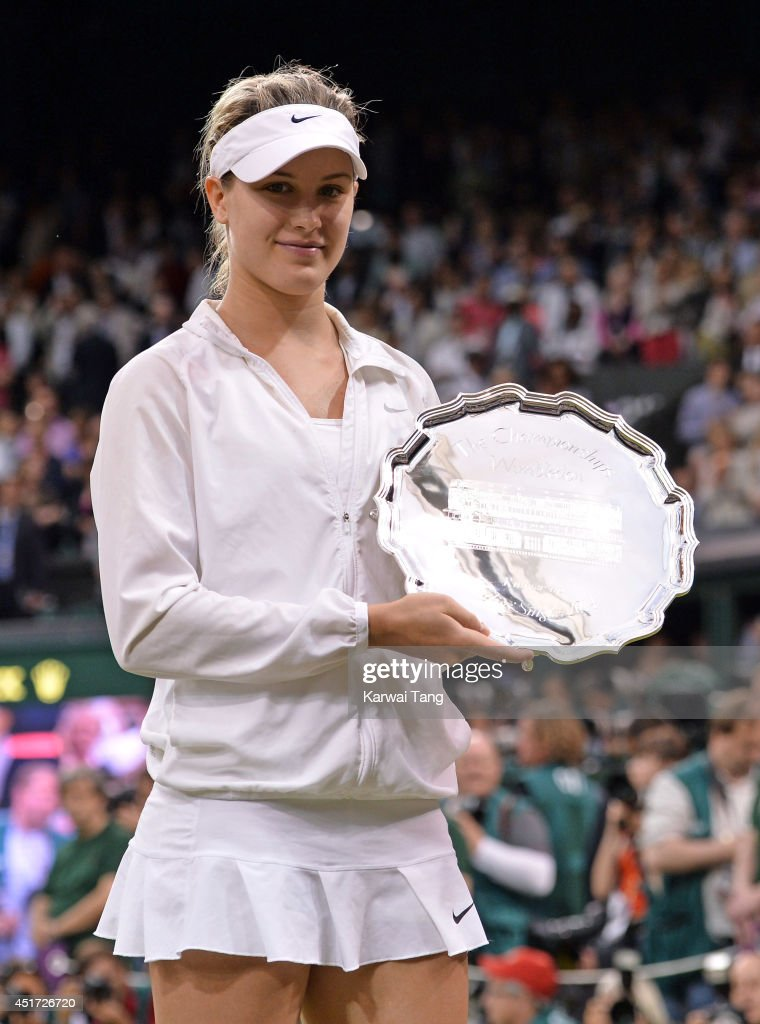 <a gi-track='captionPersonalityLinkClicked' href=/galleries/search?phrase=Eugenie+Bouchard&family=editorial&specificpeople=5678779 ng-click='$event.stopPropagation()'>Eugenie Bouchard</a> poses the runners-up trophy after losing to Petra Kvitova in the ladies singles final on centre court during day twelve of the Wimbledon Championships at Wimbledon on July 5, 2014 in London, England.
