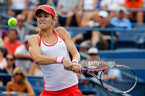 Eugenie Bouchard returns a shot to Dominika Cibulkova of Slovakia during their Women's Singles Third Round match on Day Five of the 2015 US Open at...