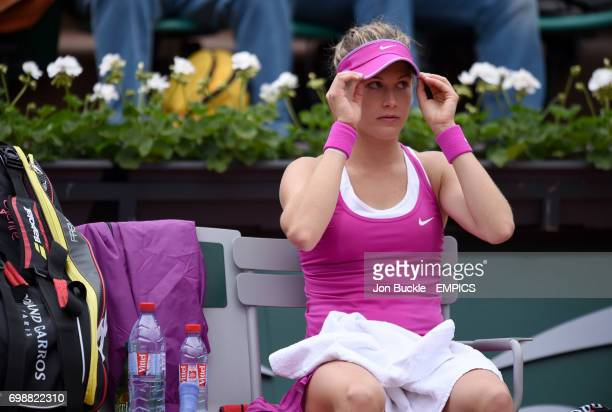 Eugenie Bouchard sits dejected during her 1st round women's singles match against Kristina Mladenovic on day three of the French Open at Roland...