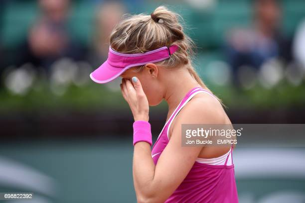 Eugenie Bouchard wipes her face dejected during her 1st round women's singles match against Kristina Mladenovic on day three of the French Open at...