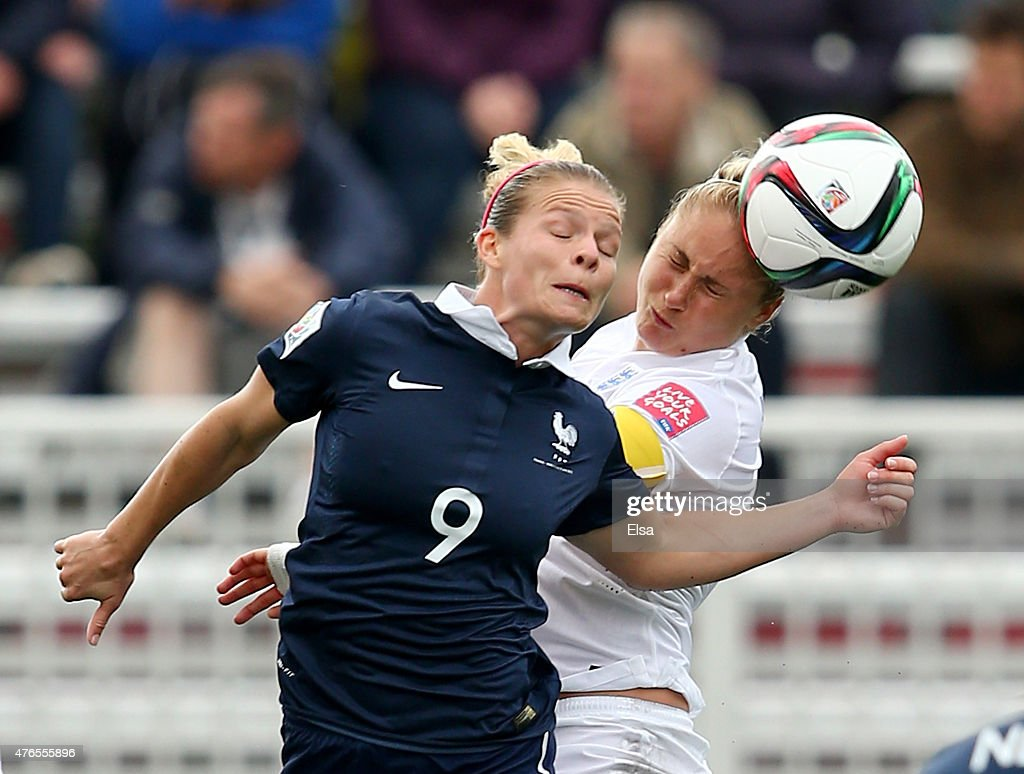 Eugenie Le #9 of France and Steph Houghton #5 of England fight for the ball during the FIFA Women's World Cup 2015 Group F match at Moncton Stadium on June 9, 2015 in Moncton, Canada.