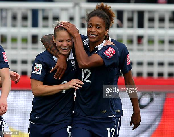 Eugenie Le of France is congratulated by teammate Elodie Thomis after Le scored in the first half against England during the FIFA Women's World Cup...