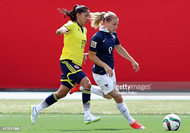 Eugenie Le Sommer of France battles for the ball with Carolina Arias of Colombia during the FIFA Women's World Cup Group F match between France and...