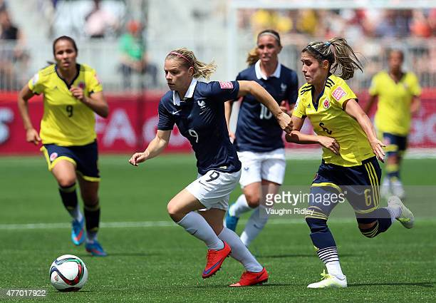 Eugenie Le Sommer of France battles for the ball with Daniela Montoya of Colombia during the FIFA Women's World Cup Group F match between France and...