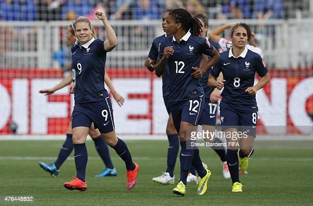 Eugenie Le Sommer of France celebrates scoring the opening goal with team mates during the FIFA Women's World Cup 2015 Group F match between France...