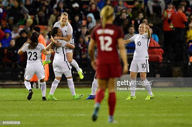 Eugenie Le Sommer of France celebrates with her teammates after scoring a goal against the United States of America in the first half during the 2017...