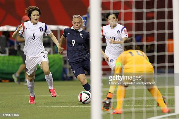 Eugenie Le Sommer of France controls the ball past Korea's defence during the FIFA Women's World Cup Canada 2015 round of 16 match between France and...