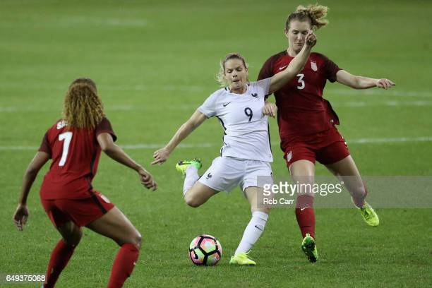 Eugenie Le Sommer of France kicks the ball in front of Samantha Mewis of the United States in the second half during the 2017 SheBelieves Cup at RFK...