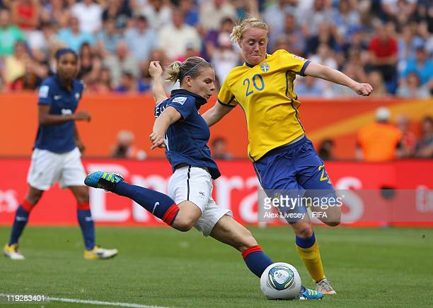 Eugenie Le Sommer of France shoots past Marie Hammarstrom of Sweden during the FIFA Women's World Cup 3rd Place Playoff between Sweden and France at...