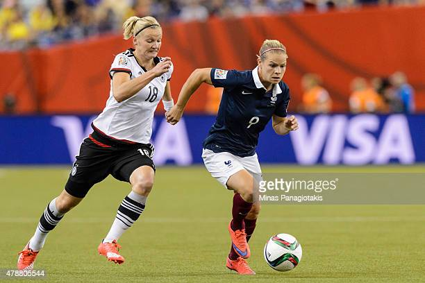Eugenie Le Sommer of France tries to move the ball with Alexandra Popp of Germany close behind during the 2015 FIFA Women's World Cup quarter final...