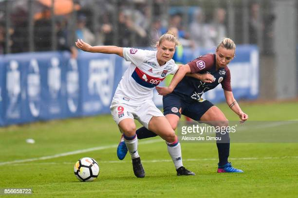 Eugenie Le Sommer of Lyon and Marion Torrent of Montpellier during the women's Division 1 match between Montpellier and Lyon on September 30 2017 in...