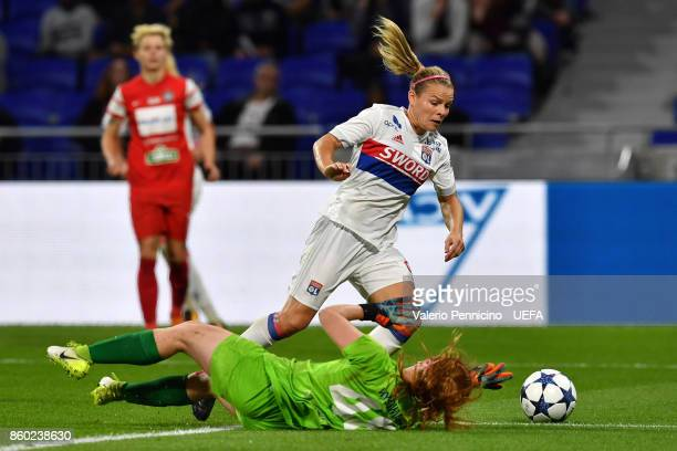Eugenie Le Sommer of Lyon is tackled by Paulina Dudek of Medyk Konin during the UEFA Women's Champions League Round of 32 Second Leg match between...