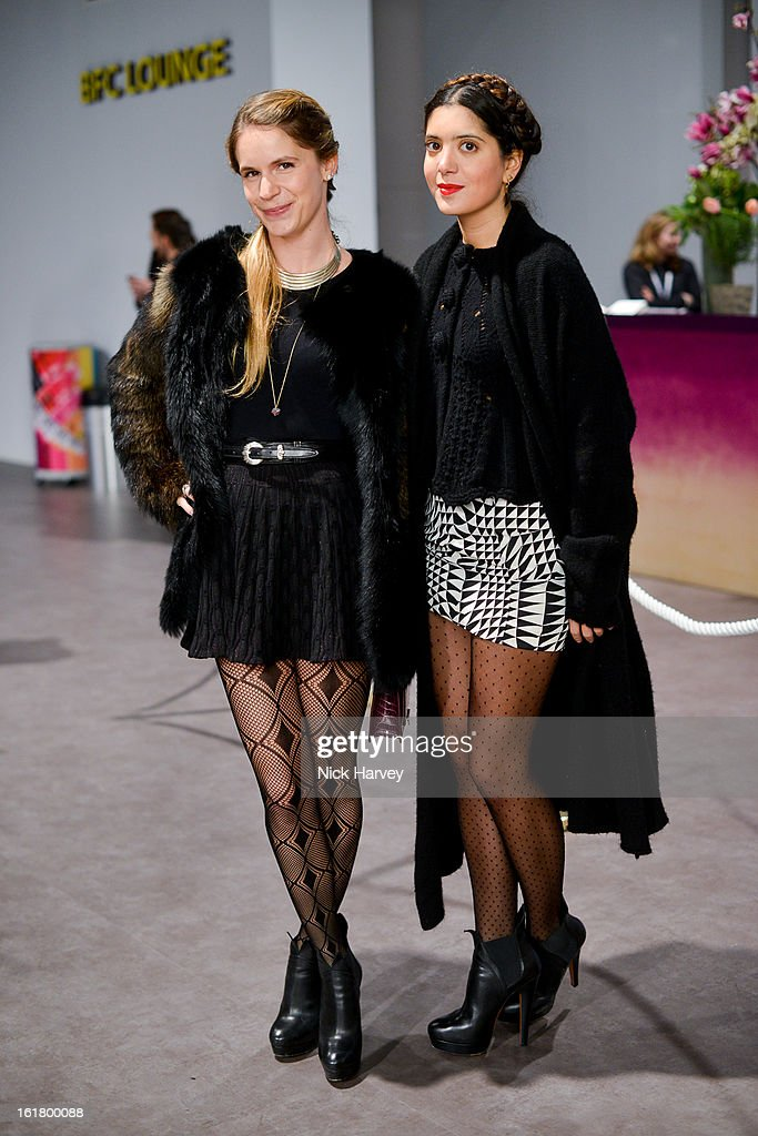 Eugenie Niarchos (L) and Noor Fares attend the Issa London show during London Fashion Week Fall/Winter 2013/14 at Somerset House on February 16, 2013 in London, England.