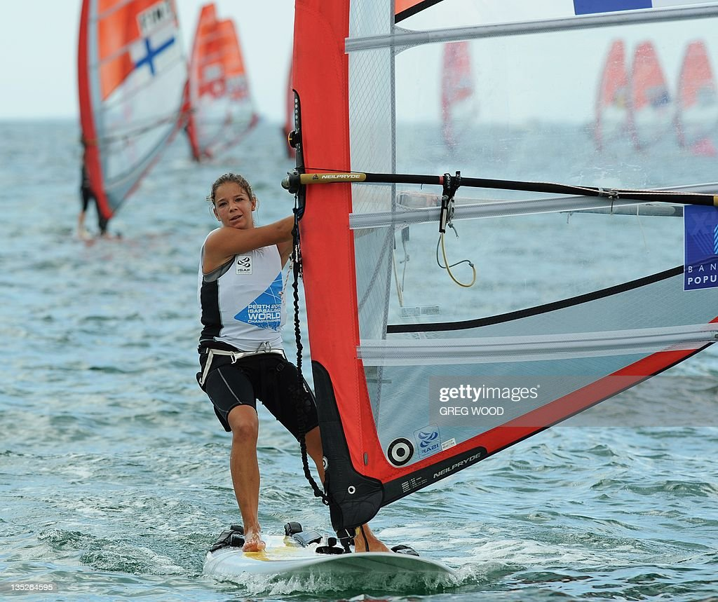 Eugenie Ricard of France crosses the finish line to complete the first Gold Fleet race in the