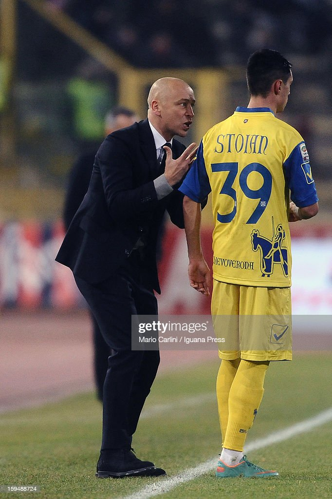 Eugenio Corini (L), head coach of AC Chievo Verona talks to his player Adrian Stoian # 39 of AC Chievo Verona during the Serie A match between Bologna FC and AC Chievo Verona at Stadio Renato Dall'Ara on January 12, 2013 in Bologna, Italy.