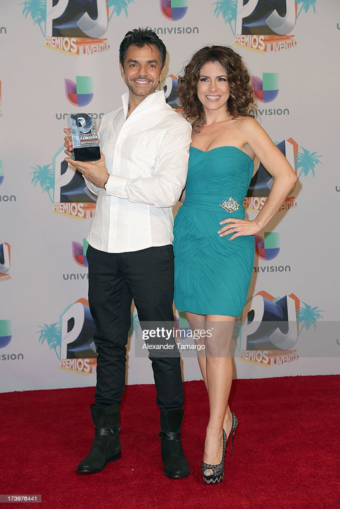Eugenio Derbez and Alessandra Rosaldo pose in the press room during the Premios Juventud 2013 at Bank United Center on July 18, 2013 in Miami, Florida.