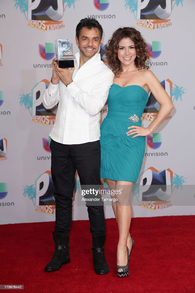 <a gi-track='captionPersonalityLinkClicked' href=/galleries/search?phrase=Eugenio+Derbez&family=editorial&specificpeople=580445 ng-click='$event.stopPropagation()'>Eugenio Derbez</a> and Alessandra Rosaldo pose in the press room during the Premios Juventud 2013 at Bank United Center on July 18, 2013 in Miami, Florida.