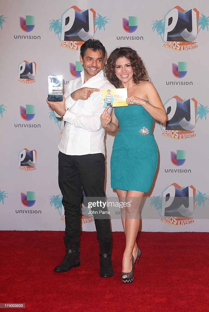 Eugenio Derbez and Alessandra Rosaldo pose in the press room during the Premio Juventud 2013 at Bank United Center on July 18, 2013 in Miami, Florida.