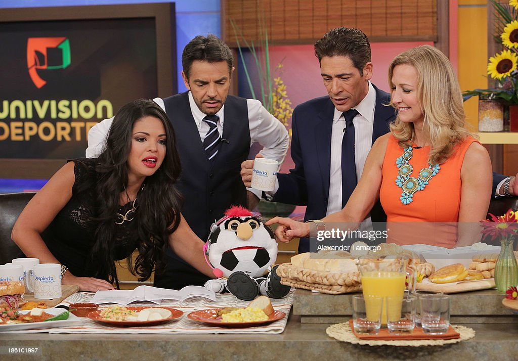 Eugenio Derbez, Johnny Lozada and Lara Spencer are seen on the set of Despierta America for simulcast with 'Good Morning America' and Fusion's the Morning Show' at Univision Headquarters on October 28, 2013 in Miami, Florida.