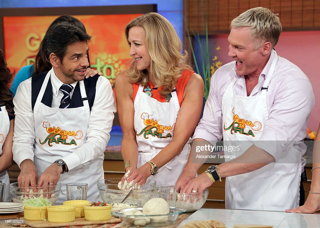 Eugenio Derbez, Lara Spencer and Sam Champion are seen on the set of Despierta America for simulcast with 'Good Morning America' and Fusion's the Morning Show' at Univision Headquarters on October 28, 2013 in Miami, Florida.