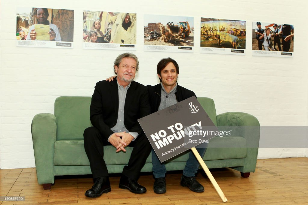 Eugenio Garcia and Gael Garcia Bernal attend a photocall to promote his Oscar nominated film 'No', which tells the story of Chilean dictator Augusto Pinochet at The Human Rights Action Centre on January 30, 2013 in London, England.