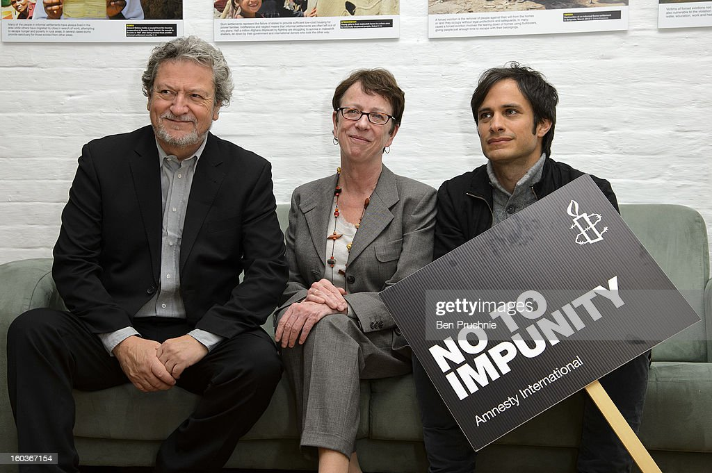 Eugenio Garcia, Kate Allen and Gael Garcia Bernal attends a photocall to promote his Oscar nominated film 'No', which tells the story of Chilean dictator Augusto Pinochet at The Human Rights Action Centre on January 30, 2013 in London, England.
