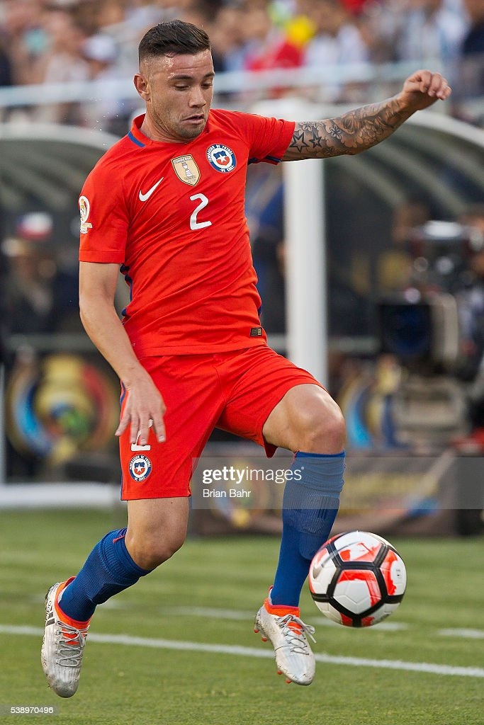 <a gi-track='captionPersonalityLinkClicked' href=/galleries/search?phrase=Eugenio+Mena&family=editorial&specificpeople=5900221 ng-click='$event.stopPropagation()'>Eugenio Mena</a> of Chile controls the ball during a group D match between Argentina and Chile at Levi's Stadium as part of Copa America Centenario US 2016 on June 06, 2016 in Santa Clara, California, US.