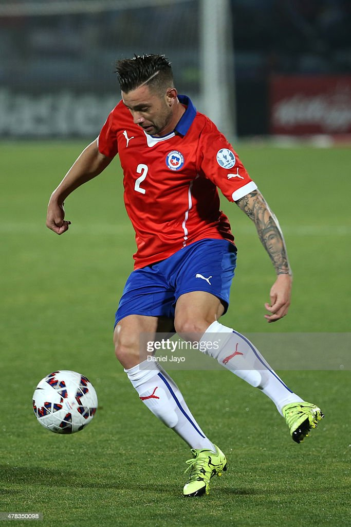 <a gi-track='captionPersonalityLinkClicked' href=/galleries/search?phrase=Eugenio+Mena&family=editorial&specificpeople=5900221 ng-click='$event.stopPropagation()'>Eugenio Mena</a> of Chile drives the ball during the 2015 Copa America Chile quarter final match between Chile and Uruguay at Nacional Stadium on June 24, 2015 in Santiago, Chile.