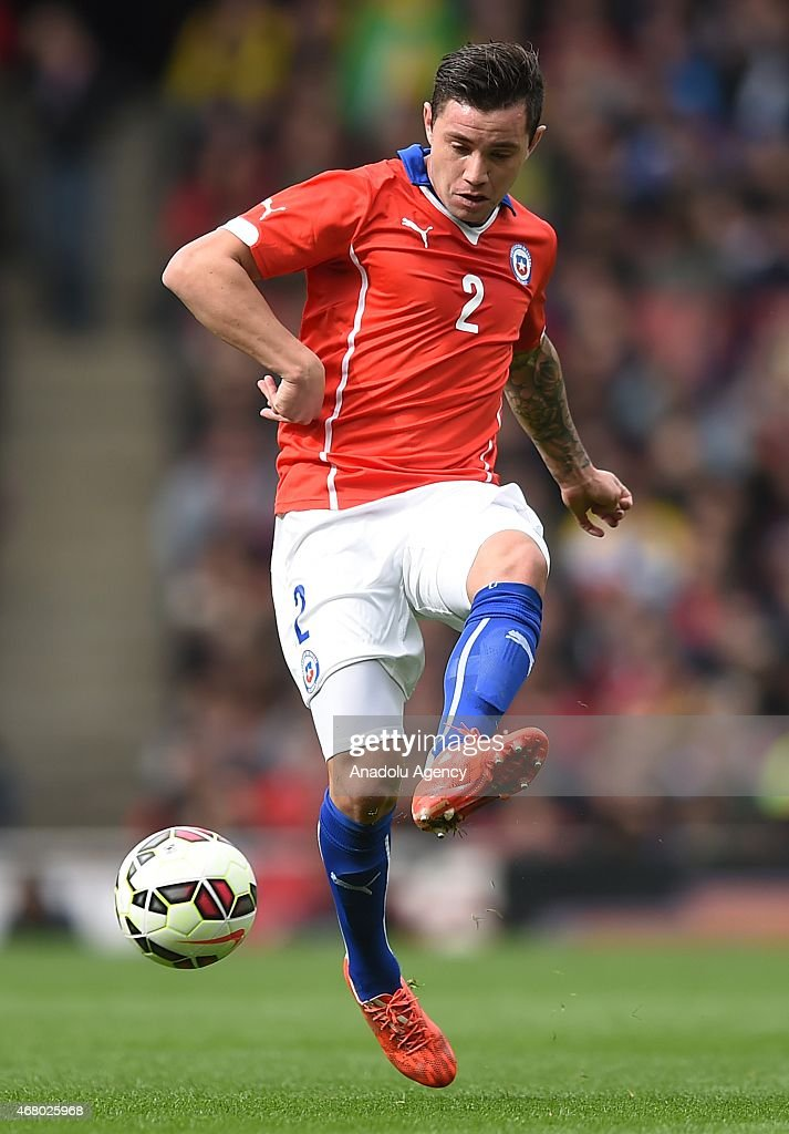 <a gi-track='captionPersonalityLinkClicked' href=/galleries/search?phrase=Eugenio+Mena&family=editorial&specificpeople=5900221 ng-click='$event.stopPropagation()'>Eugenio Mena</a> of Chile in action during the International Friendly match between Brazil and Chile at The Emirates Stadium in London, England on March 29, 2015.