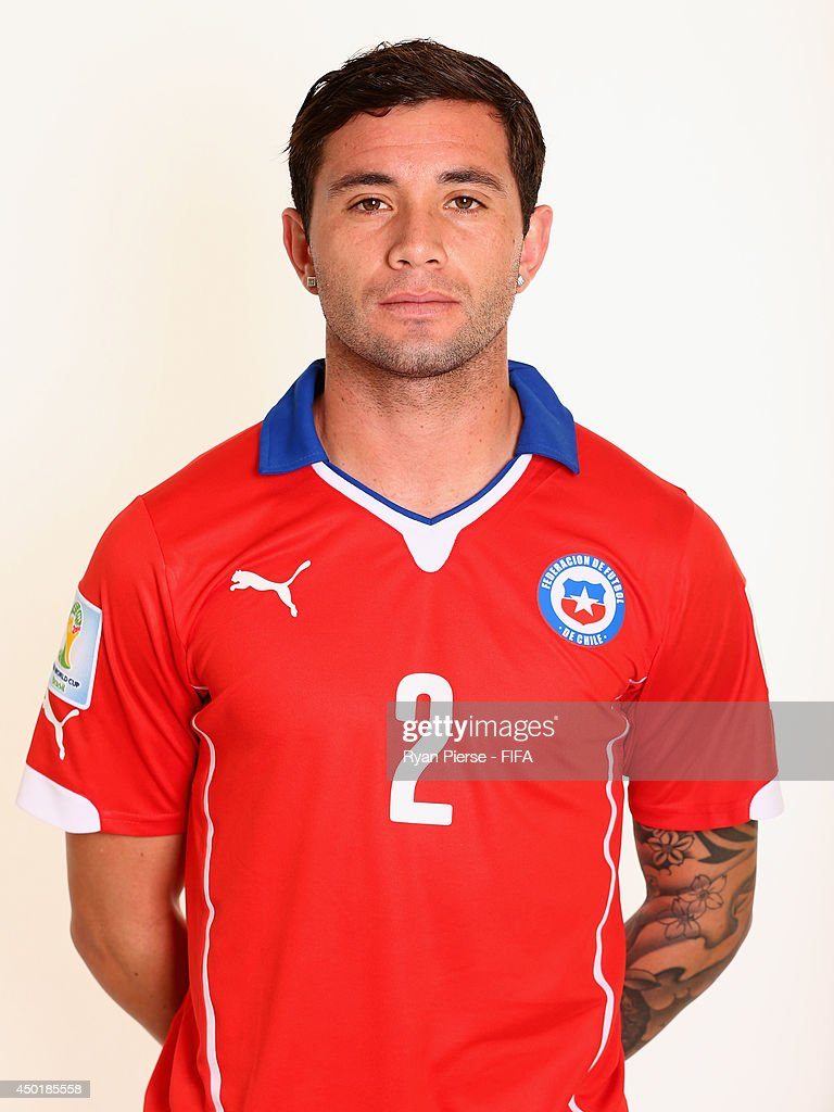 <a gi-track='captionPersonalityLinkClicked' href=/galleries/search?phrase=Eugenio+Mena&family=editorial&specificpeople=5900221 ng-click='$event.stopPropagation()'>Eugenio Mena</a> of Chile poses during the official FIFA World Cup 2014 portrait session on June 6, 2014 in Belo Horizonte, Brazil.