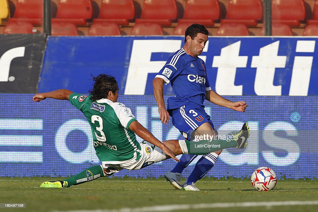 Eugenio Mena of Universidad de Chile fights for the ball with Cristian Oviedo of Audax Italiano during a match between Universidad de Chile and Audax Italiano as part of the Torneo Transición 2013 at Santa Laura Stadium on February 01, 2013 in Santiago, Chile.