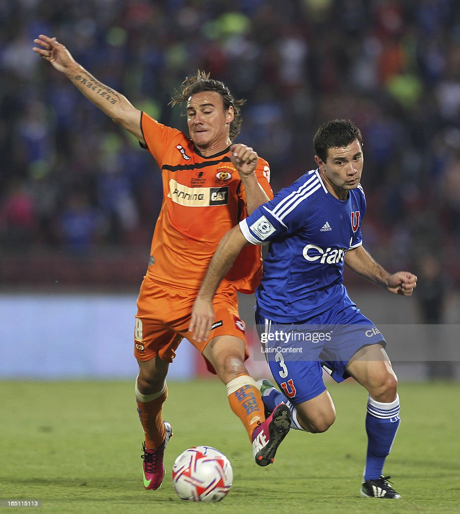 Eugenio Mena of Universidad de Chile, struggles for the ball with Marcos Pol of Cobreloa during a match between Universidad de Chile and Cobreloa as part of the Torneo Transicion 2013 at Estadio Nacional on March 30, 2013 in Santiago, Chile.