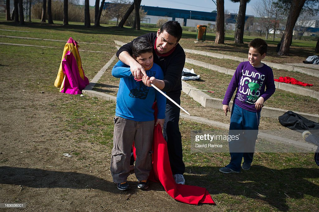 Eugenio Perucha teaches his son Julian Perucha how to hold the sword for killing fighting bulls as they practice bullfighting in a city park in Santa Perpetua de la Mogoda on March 3, 2013 in Barcelona, Spain. On February 12 the Spanish Parliament accepted a petition from bullfight supporters asking for the sport to become a key part of the Spain's cultural heritage. The petition, of 590,000 signatures, has been promoted by the Federation of Bullfighting Entities of Catalonia. The last bullfight in Catalonia was held in September 25, 2011.