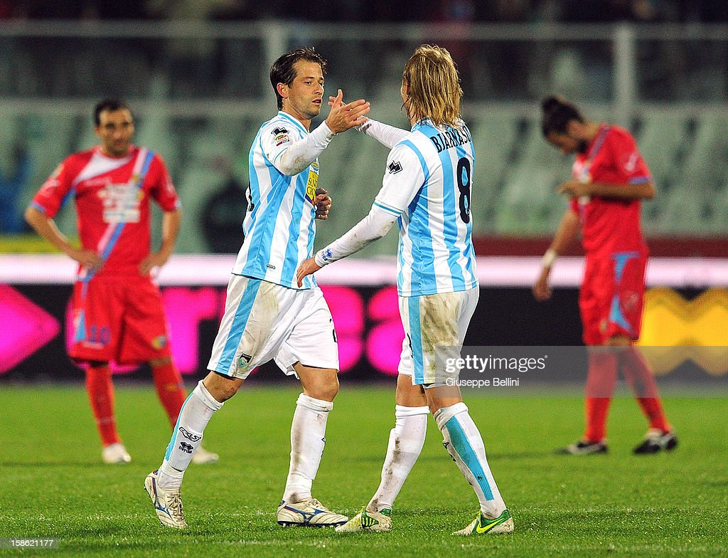 Eugenio Romulo Togni of Pescara celebrates with team-mate Birkir Bjarnason after scoring the goal 2-1 during the Serie A match between Pescara and Calcio Catania at Adriatico Stadium on December 21, 2012 in Pescara, Italy.